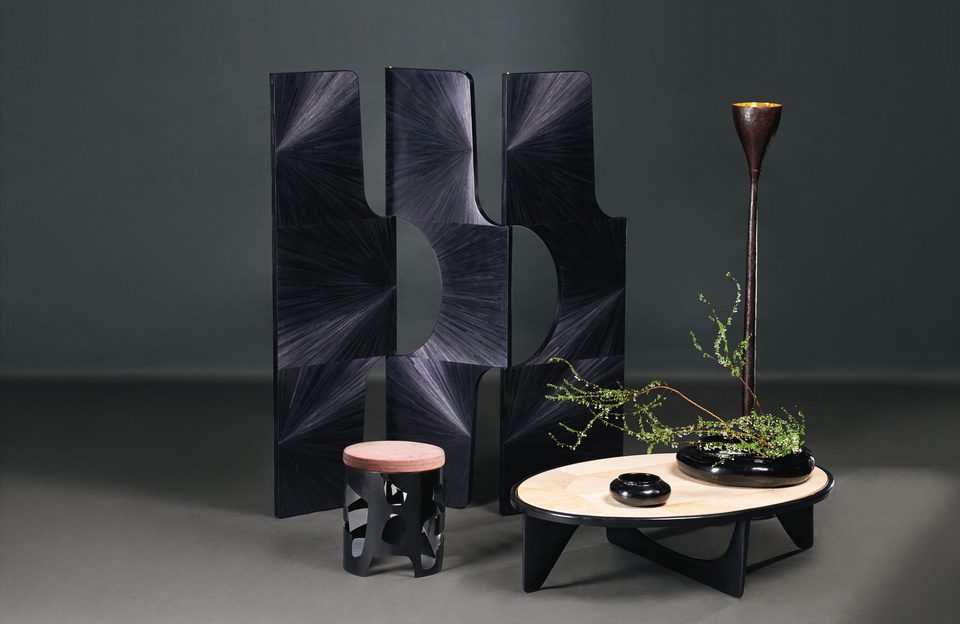 INTARSIA Luminous Iridescence Intarsia is an homage to texture and balance in design; a personal statement of surfaces and forms that draw from my over-lapping passions for antiquity and nature. Intarsia is a forms by hand, piece-by-piece, making objects of vital harmony.