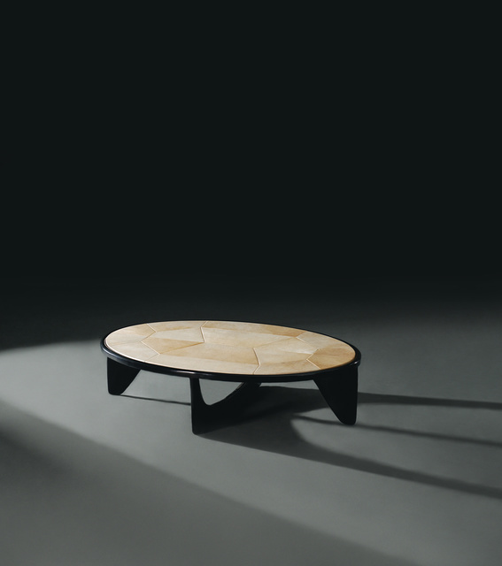 Turtle Coffee Table FG003678 Intarsia Dorsal shapes, sculpted base and a rawhide surface of forms create an organic and flowing maritime energy. Slender black bronze patinated fins support an oval ring and table surface 'carapace' of hand-shaped raw parchment