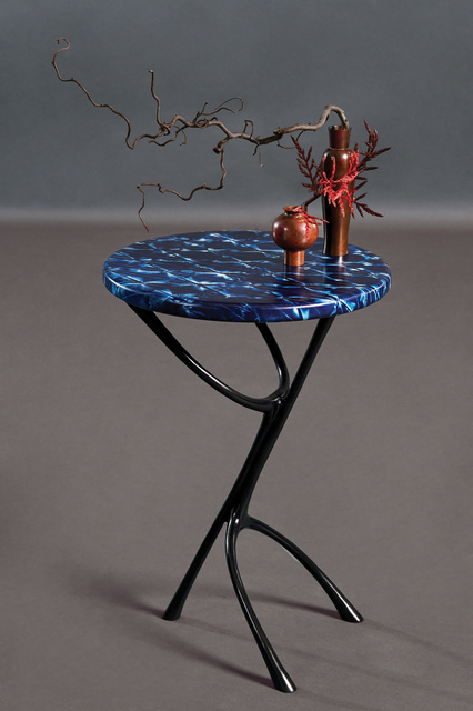 Wishbone Side Table FG003684 Intarsia Any great dringks table should have beautiful sensuous legs and a top that mystifies and asks to be touched.  Cool black bronze patina lines lift the top which is made from parchment hand-dyed in natural indigo with a complex shibori pattern.